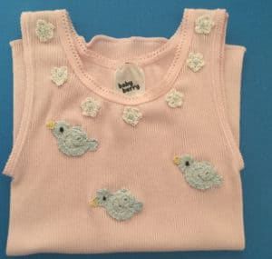 Crochet baby singlet with flowers and birds, landscape