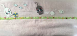 Crochet cat, mouse and bird towel