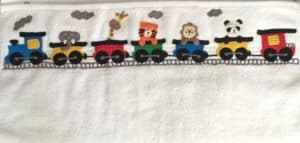 Finished crochet train series on a towel