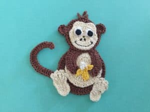 Finished crochet monkey with hair landscape