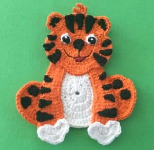 Crochet crouching tiger body with paws