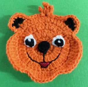 Crochet crouching tiger head with eyes