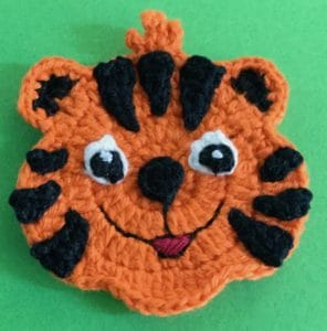 Crochet crouching tiger head with spots