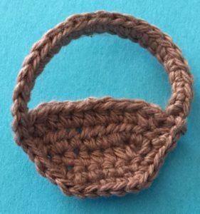 Crochet girl with basket basket neatening