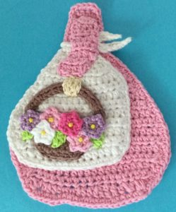 Crochet girl with basket basket with flowers