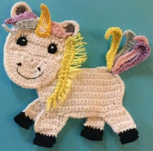 Crochet unicorn body with first mane piece