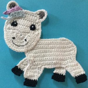 Crochet unicorn body with front head piece