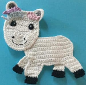 Crochet unicorn body with side head piece