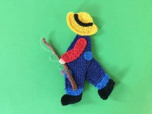 Finished crochet boy with a fishing rod landscape