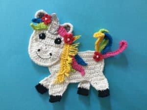 Finished crochet unicorn bright landscape