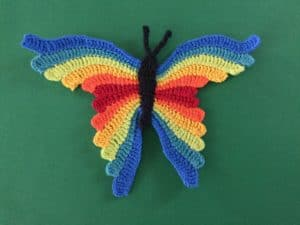 Finished crochet butterfly green background landscape