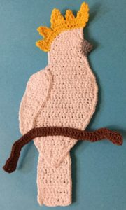Crochet cockatoo body with branch