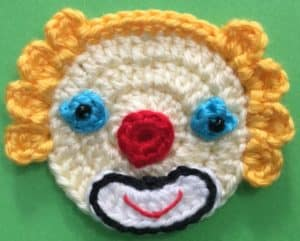 Crochet clown with tophat head with eyes