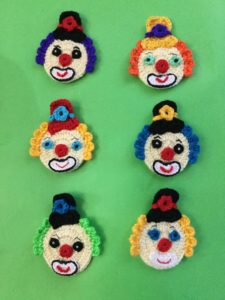 Finished crochet clown with tophat group portrait