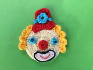 Finished crochet clown with tophat landscape