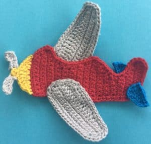 Crochet airplane applique body with tail flaps
