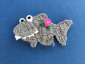 Finished crochet shark with flower landscape