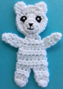 Crochet teddy for plane mobile body with eyes