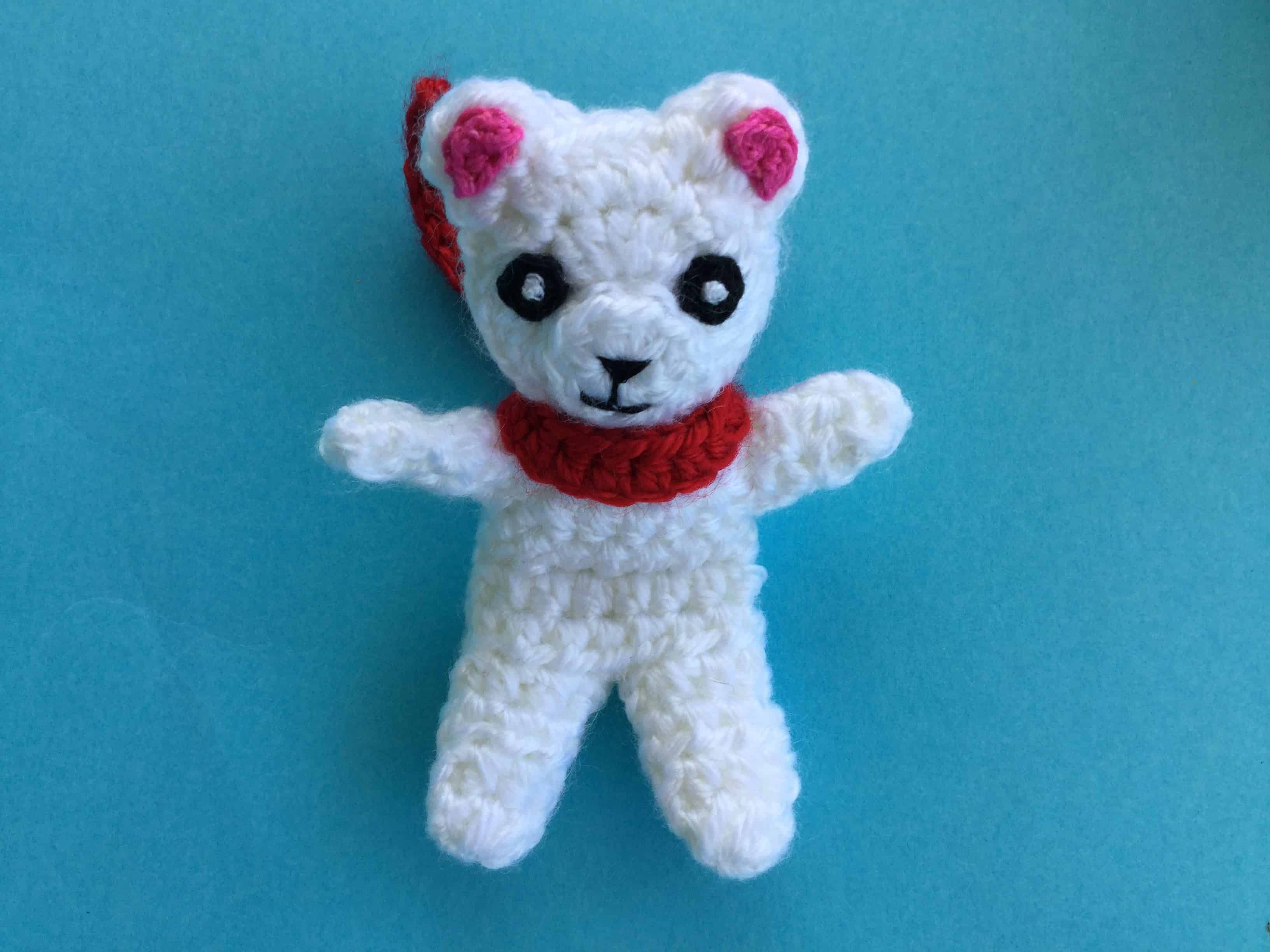 Finished crochet teddy for plane mobile with scarf landscape