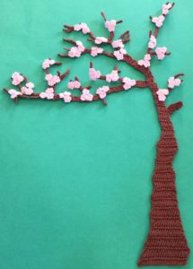 Crochet blossoms and swing tree with blossoms
