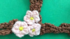 Crochet blossoms and swing tree with blossoms closeup