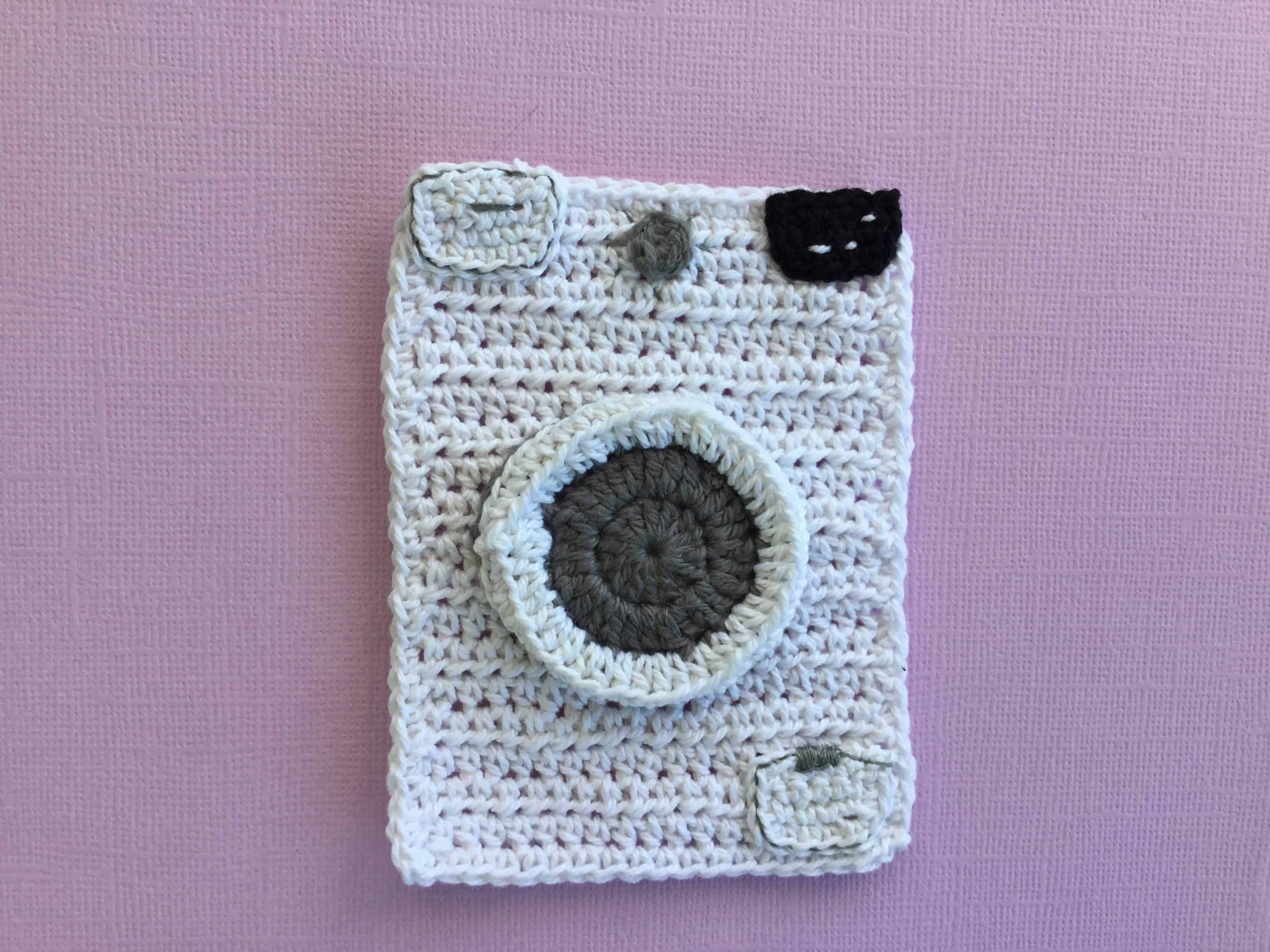 Finished crochet washing machine landscape